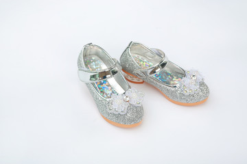 Pair of fashion princess shoes on white background. Baby shoes.