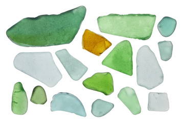 Pieces of colored bottle glass are turned in waves of the Baltic Sea