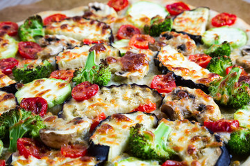 Homemade pizza with vegetables, natural dough on leaven. With zucchini, eggplant, cherry tomato, broccoli, mushrooms. The concept of a healthy diet. Vegetarian.