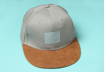 Rapper man's cap on a blue pastel background.