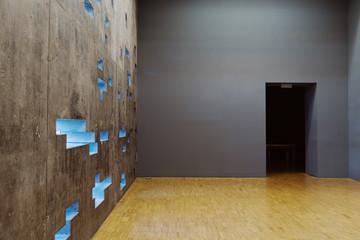 Concrete futuristic wall with black enter