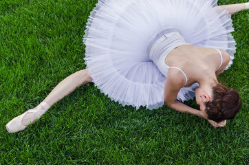 Ballerina stretching outside top view