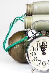 Timed bomb. Old alarm clock with a bomb. Danger of explosion. The concept of terrorism.
