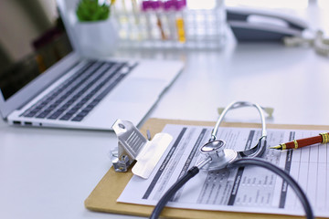 Doctor's workspace working table with patient's discharge blank