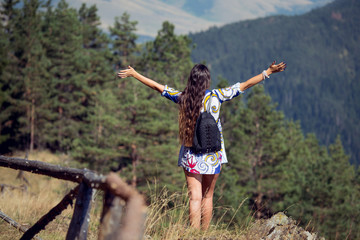 Women spreading hands feelings happy and relaxing look at the mountain and sky
