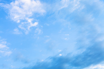 white and gray clouds in blue evening sky