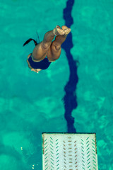 Wall Mural - Female diver jumping into the pool