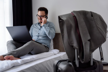 Businessman using computer on a business trip. Traveling for work.