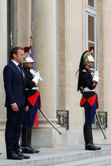 French President Emmanuel Macron waits for the arrival of Azerbaijan's President Ilham Aliyev at the Elysee Palace in Paris