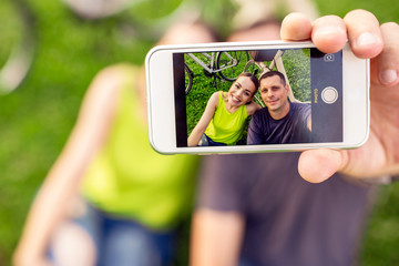 Beautiful young couple in love taking selfie in the park.