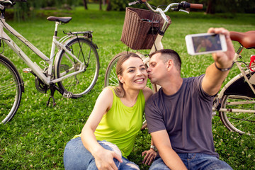 love, technology, relationship, family and people concept - young couple taking selfie.