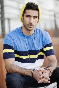 Portrait of fashionable young man wearing cap an striped t-shirt