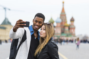 Russia, Moscow, couple taking a selfie and smiling