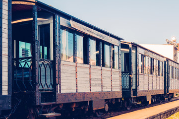 Beautiful vintage train with wooden cars, toned