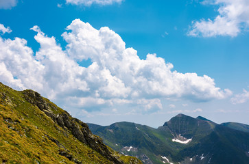 beautiful cloudscape over the Fagaras mountains. Bright sunny day in Romania. beautiful nature background