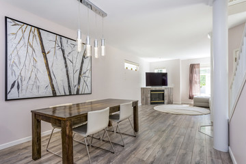 Modern dining area with a wooden table and leather chairs.