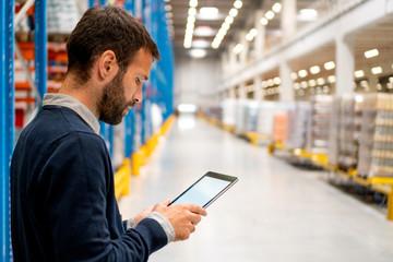 Manager holding digital tablet
