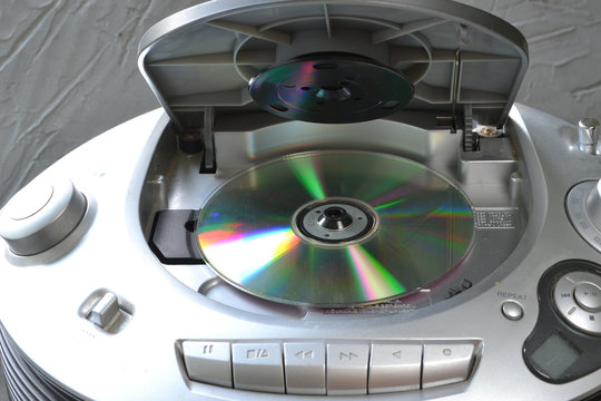 CD player with an open lid.