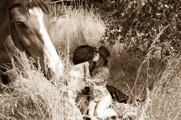 Cowboy, Cowgirl country and western couple with horse and saddle on ranch