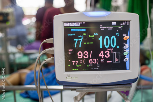 Modern vital sign monitor on patient background at ward in the