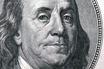 Dollars closeup. Benjamin Franklin's portrait on a  bill.Concept of money and earnings.