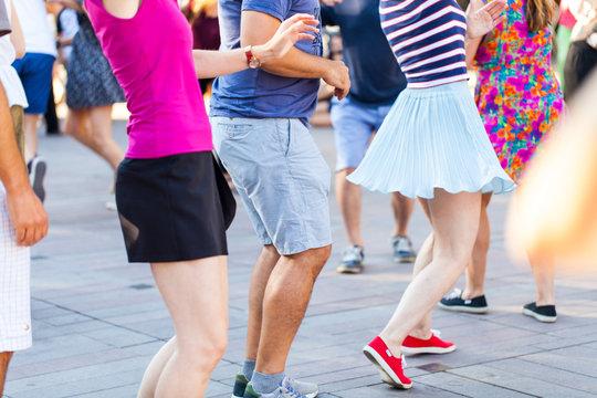 Group of people dancing swing outdoors