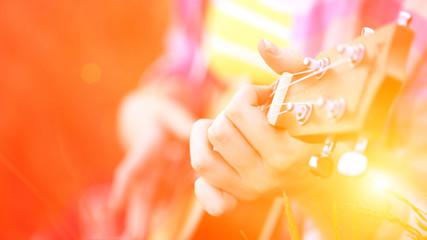 hands playing a guitar close-up