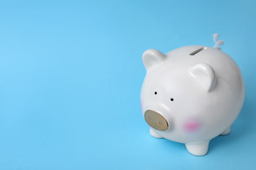 White piggy bank on color background. Money saving