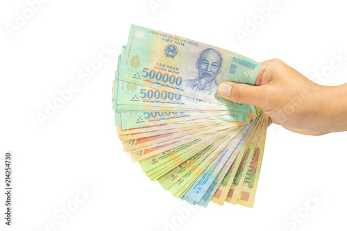 clipping path Money in Vietnam on right hand (Socialist Republic Of  Vietnam), Dong