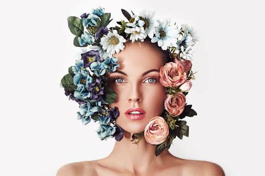 Portrait of a young beautiful woman with flowers on her head. Spring fashion photo. Skin care concept, beauty spa, bio product.