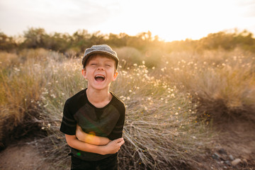 Young Boy Laughing in Desert