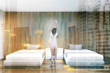 Wood wall hotel suite interior, two beds, woman Wall mural