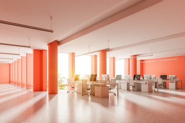 Corner of a spacious red wall open space office