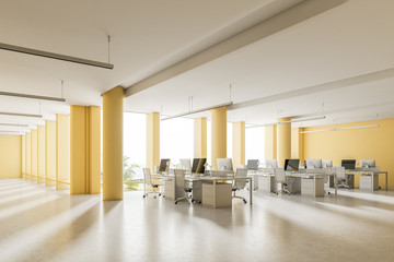 Corner of a spacious yellow wall open space office