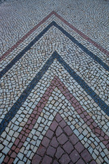 mosaic arrow shows direction. paving stones symbol for rising success summit. path in triangle design.