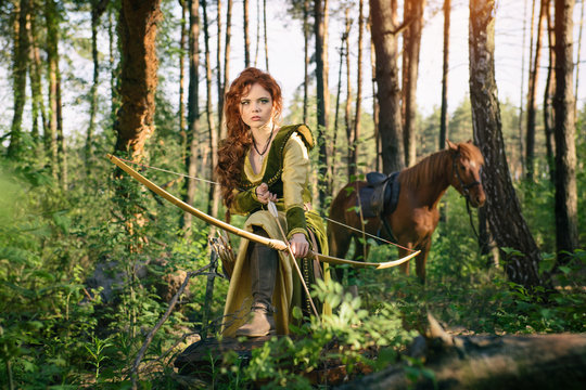 Fantasy medieval woman hunting in mystery forest