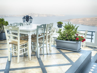 Santorini table and chairs balcony, Greece