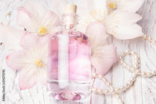 Perfume bottle and white flowers stock photo and royalty free perfume bottle and white flowers mightylinksfo