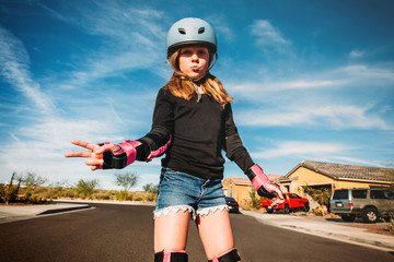 Young Girl on Rollerblades in Street