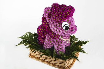 basket with a composition of fresh cut flowers in the form of My Little Pony