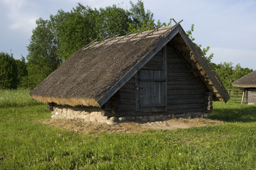 Ancient Belarusian (Russian) village, wooden cellar with authentic roof