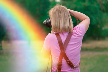 Woman is a professional photographer with dslr camera, outdoor and sunlight