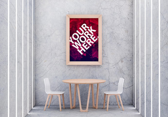 Framed Poster with Table and Chairs in Concrete Room Mockup