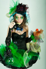 Fotobehang Schilderkunstige Inspiratie fashion model with creative make-up blowing soap bubbles