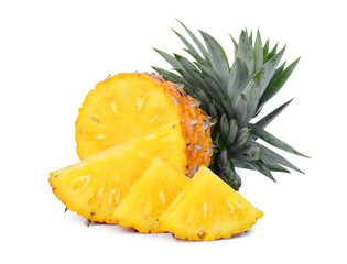 half and slices ripe pineapple with leaves isolated on white background