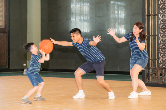 Happy family playing basketball.