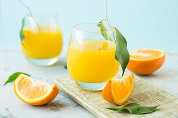 Splash on a diet orange juice against a blue background