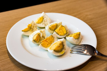 Boiled eggs with salt pepper and olive oil