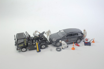 a worker figure with the tow truck