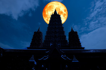 full blood moon back silhouette triple pagoda in night sky